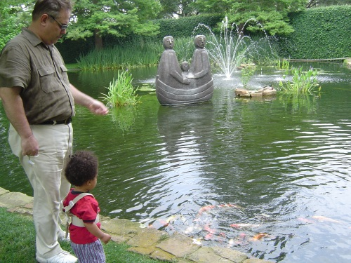 Alexander and Daddy hanging out at the koi pond at the Anatole Hotel in Dallas.
